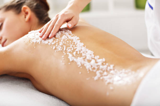 Picture of beautiful woman getting exfoliation treatment in spa